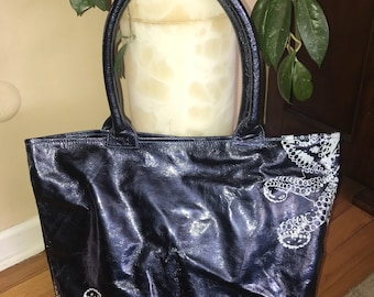 Large leather tote suede inside with beautiful sea designs! Perfect beach tote
