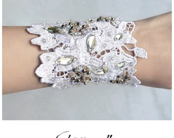 CWC011 - Handmade white lace bridal cuff with clear, silver and dusty pink Swarovski crystals.