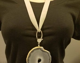 Grey and white agate pendant on a suede strap.