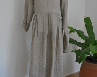 handwoven linen dress in a natural color, buggy with long sleeves ready to be shipped