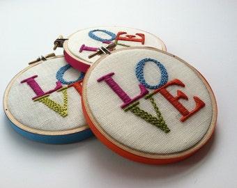 LOVE hoop art by mlmxoxo. hand embroidered. engagement. wedding. anniversary. fiber art. magenta. aqua. citrine. orange. embroidery hoop art