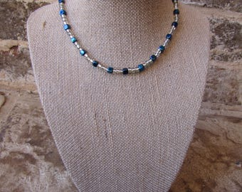 Gold and blue beaded necklace with a clasp