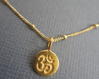 Om Necklace, Tiny Om pendant necklace, Gold Om charm on 14K Goldfill Satellite Chain. Visit  Lotus411 more buddhist jewelry.