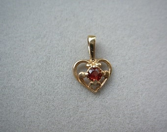 Gold, 14ky heart pendant with garnet.