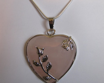 Heart shaped Rose Quartz stone and silver pendant with free 18 inch 925 stamped silver snake chain.