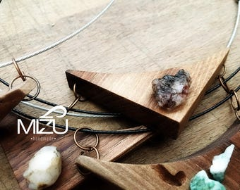 Pendant in walnut and mixed oxidized iron-quartzite created and finished by hand