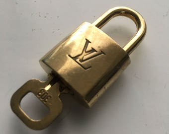 Authentic Preowned Louis Vuitton brass lock and key #303