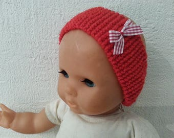 Red headband topped with a red gingham bow