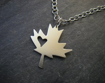 Sterling silver maple leaf with heart cutout