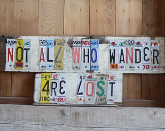 """Inspirational Recycled License Plate Barn Wood Sign - """"Not all who wander all lost"""" - J.R.R Tolkien"""