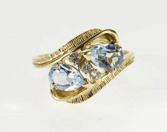 10K Pear Blue Topaz Cubic Zirconia Ornate Bypass Ring Size 6.75 Yellow Gold