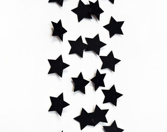Black stars garland in cardboard