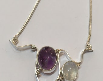 Solid silver wave design necklace set with moonstone and amethyst
