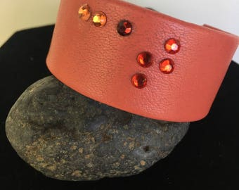 """Leather cuff with """"CAT"""" in braile beads."""