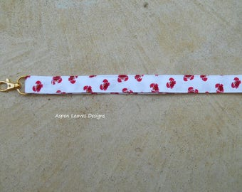 Red crab fabric lanyards plus charms. Tiny red crabs on white fabric. Summer or beach theme. Secret santa gifts.