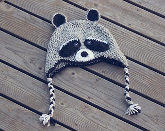 Raccoon earflap hat