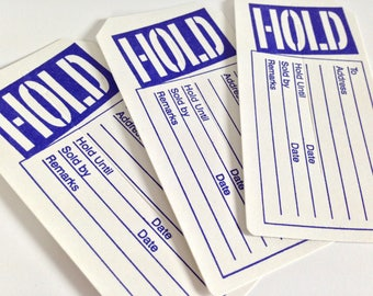 Hold merchandise tags with slits