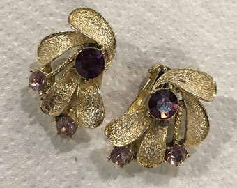 Vintage Signed CORO Goldtone Earrings with a Purple Glass Center