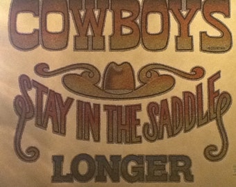 Cowboys stay in the saddle longer iron on