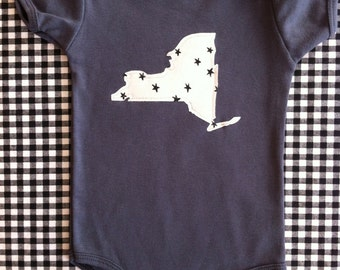 custom baby onesie, YOUR STATE, black/white star graphic pattern, new york minnesota california illinois ohio texas washington oregon ...