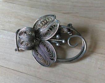 Vintage silvertone filigree flower brooch pin