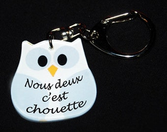 """OWL Keychain white message """"We're nice"""""""