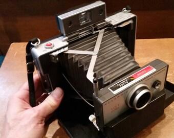 Polaroid 101 land camera with flashgun #268