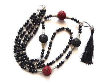 Asian Saltire in cinnabar and black glass beads and her Pompom-ethnic chic