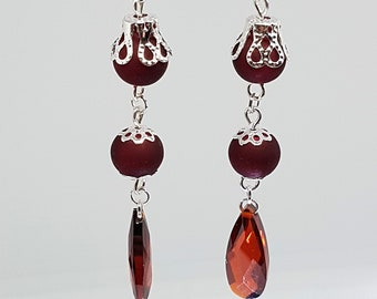Red cut glass dangle earrings with red glass beads and silver flower caps