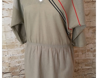 Gorgeous 70's khaki green batwing dress with geometric detail