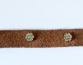 brown suede bracelet with flower accents