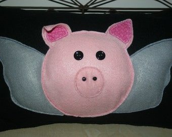 Winged pig decorative pillow