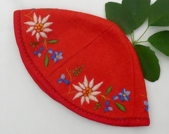 Child's folk cap, vintage.   It is red felt sewn in 4 sections & hand embroidered with Alpine flowers. c 1930s to 50's thereabouts.