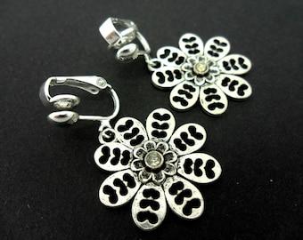 A hand made tibetan silver  flower themed  clip on earrings.