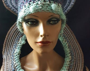 Singularly designed combination of hat with necklace.