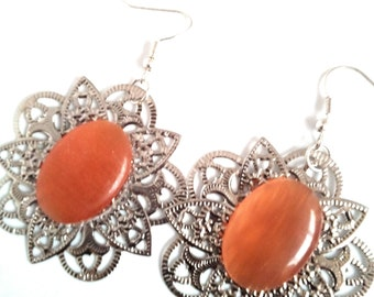Earrings print with orange cabochon