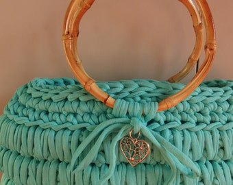 Crochet t-shirt yarn bag  in the color sea green.