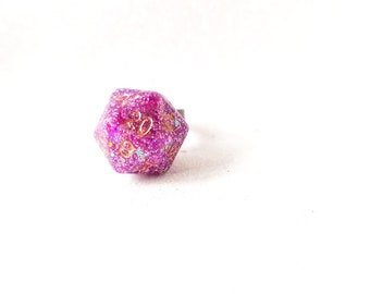 Individually cast clear resin D20 dice ring with pink and gold glitter