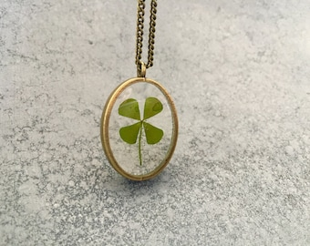 Four Leaf Clover in a dainty Oval Open-Back Antique Bronze Bezel Resin Necklace, Four Leaf Clover Necklace, Pressed Flower Jewelry
