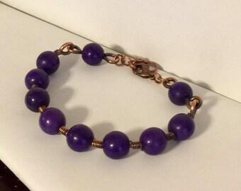 Wire wrapped purple bead bracelet