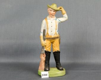Vintage western figurine Red hair Dark eyes Hat Six shooter / Bullets Suspenders Rife Red mustache Made in Taiwan