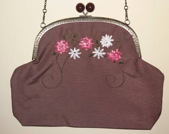 Metal nozzle bag. Embroidery