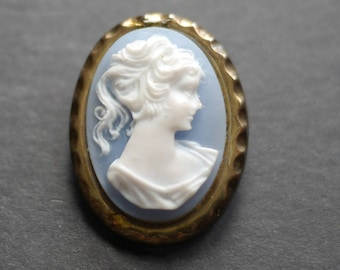 Plastic cameo small vintage brooch with lady's head on pale blue background