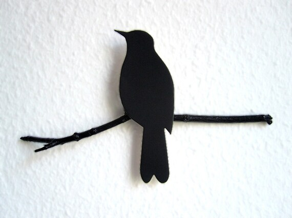 Renna Deluxe blackbird on a perch wall ornament of renna deluxe