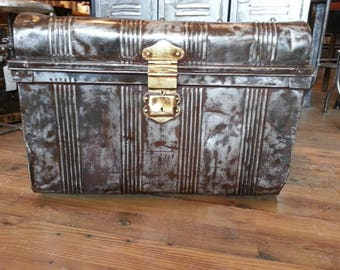 Vintage industrial stripped steel trunk with the Free Masons medallion