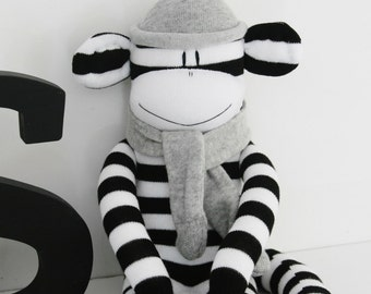 Black and White Sock Monkey with Grey Hat and Scarf