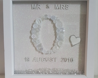 Handmade personalised Mr & Mrs frame. All produced in white, with the initial of the newly weds surname and the date of the wedding.