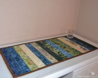 Quilted batik table runner in green and blue. Quilted table runner, batik table topper, centrepiece, home decor, fabric table runner UK
