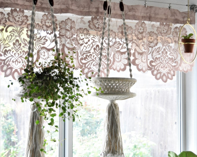 white beaded macrame plant holder