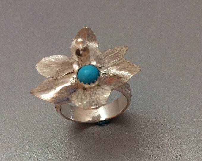 Sterling silver orchid ring with Sleeping Beauty Turquoise center